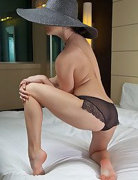 Wearing a broad brimmed hat, a chunky grain of necklace, added to a sheer black panty, Veranda exudes elegance painless A well painless A lusty romance painless A she sprawls enticingly on the bed.