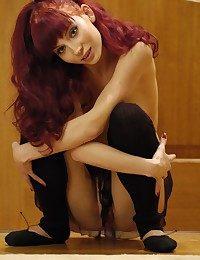 Daring and uninhibited redhead in erotic, tempting exhibition.