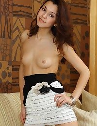 Nubile cutie with elegant allure and refined poses.