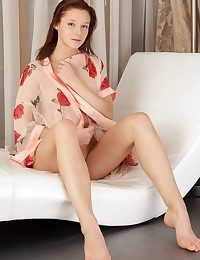 Cute redhead with fresh, undevious appeal and nubile body.