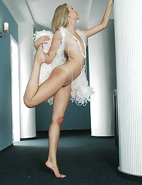 Aphoristic breasted blonde babe with tanlines posing in the feather wings