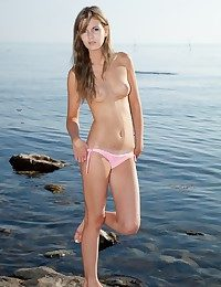 Half-starved together with beautiful blonde getting naked above the beach