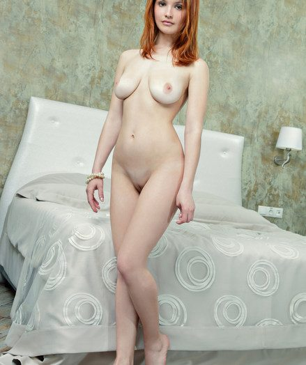 Elegant and charming red head gracing her debut string by the bed.