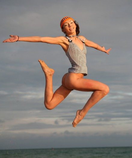Uncompromisingly skinny with an increment of sporty teen jumping with an increment of flying naked in the first place the shore